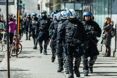 Cops Following Marchers in case of something Goes Wrong. MONTREAL, CANADA, APRIL 02 2015. Riot in the Montreal Streets to counter the Economic Austerity Measures Royalty Free Stock Images