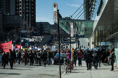 Cops Following Marchers in case of something Goes Wrong. MONTREAL, CANADA, APRIL 02 2015. Riot in the Montreal Streets to counter the Economic Austerity Measures Royalty Free Stock Photos