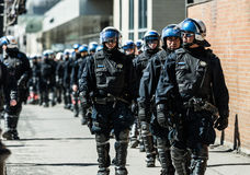 Cops Following Marchers in case of something Goes Wrong. MONTREAL, CANADA, APRIL 02 2015. Riot in the Montreal Streets to counter the Economic Austerity Measures Stock Image