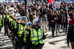 Cops Following the Marchers to make sure everything is under Co. MONTREAL, CANADA, APRIL 02 2015. Riot in the Montreal Streets to counter the Economic Austerity Stock Photo