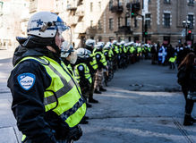 Cops making a line to Control the Protesters. MONTREAL, CANADA, APRIL 02 2015. Riot in the Montreal Streets to counter the Economic Austerity Measures. Cops Royalty Free Stock Photos