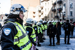 Cops making a line to Control the Protesters. MONTREAL, CANADA, APRIL 02 2015. Riot in the Montreal Streets to counter the Economic Austerity Measures. Cops Royalty Free Stock Images