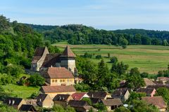 Copsa Mare saxon village with his fortified church, near Biertan, Sibiu county, Transylvania, Romania Royalty Free Stock Photos