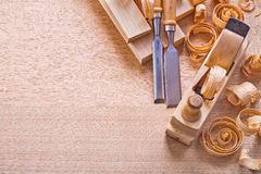 Copsypace image carpentry chisels wooden planks. Shavings plane construction concept Royalty Free Stock Photos