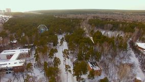 The copter flies over a Park area in the winter. Zoo with open enclosures. In winter stock video