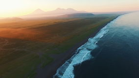 Copter flying at sunset over the sea to the mountains. Flew the ocean at sunrise.Fog mountains stock video