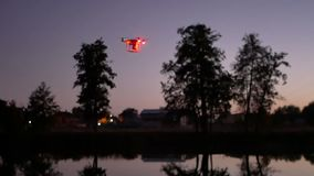 Copter night lake drone. Copter stands in the lake before take-off. Real time stock video footage