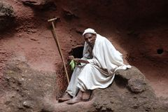 Coptic Monk in Lalibela. Old Coptic Monk in Lalibela's Rock Hewn Churches in typical religious garments Royalty Free Stock Photos