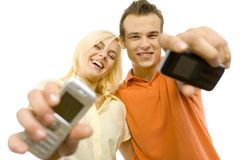 Copule con i mobiles Fotografie Stock