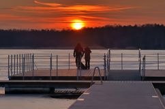 Copule in love. Over lake and sunset royalty free stock photos