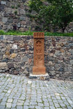 Copy of the ancient carving. The stone carved with a cross (copy of the ancient work) on the road next to Geghard monastery, Armenia stock images