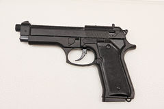 A copy of the black 9mm pistol. A copy of the gun black 9mm isolated white background Royalty Free Stock Photography