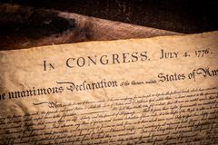 A copy of the declaration of Independence of the United States. On a wooden table Royalty Free Stock Image