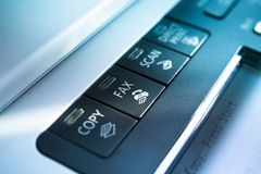 Copy and fax button. On a copy machine with blue lights Stock Images