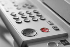 Copy machine. Copier machine - Red button in colour Royalty Free Stock Photos