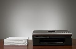 Copy Machine and a pile of papers Royalty Free Stock Images