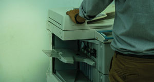 The Copy Man. Working life in the office copier purchase Royalty Free Stock Photo