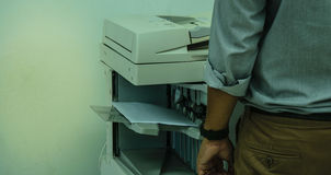 Copy Man. Working life in the office copier purchase Royalty Free Stock Images