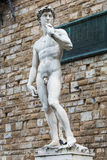 Copy of Michelangelo's David, Piazza della Signoria, Florence. A copy of the statue of David by Michelangelo, in the background of the Palazzo Vecchio in Piazza Royalty Free Stock Photos