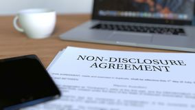 Copy of non-disclosure agreement on the desk. 3D rendering. Printed copy of contract on the desk Stock Photos