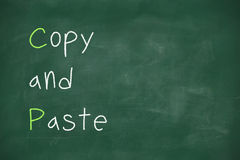 Copy and paste written on blackboard. Copy and paste handwritten on school blackboard royalty free stock images