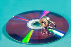Copy protection. Dvd or cd with padlock Stock Photos