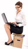 Copy space. Successful young businesswoman sitting on pile of documents, lots of copy space stock image