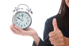 Copy space an alarm clock with woman hand showing succes sign Royalty Free Stock Photo