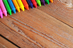 Copy space background with oil pastel crayons on a wooden table Stock Image