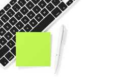 Copy Space Blank Sticky Note Paper with Pen and Keyboard. 3d Ren. Copy Space Blank Sticky Note Paper with Pen and Keyboard on a white background. 3d Rendering Royalty Free Stock Images