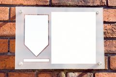 Copy Space on Brick Wall. Red brick wall holds a pinned up sheet with spaces for copy Stock Images