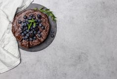 Copy space with chocolate cake with napkin. Copy space with chocolate cake with fresh berries and napkin on gray background royalty free stock photos