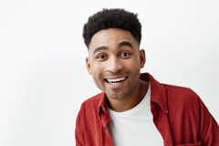 Copy space. Close up portrait of young attractive black-skinned cheerful happy man with afro hairstyle in casual white t Royalty Free Stock Image