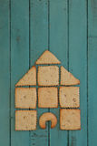 Copy Space With Cookie House Stacked on Wooden Board Stock Photos