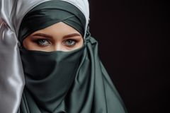 Copy space. devout Muslim female. Peaceful religion. Arabian woman with beautiful makeup royalty free stock image