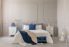 Copy space on grey wall of scandinavian bedroom interior with blue, white and grey design. Copy space on empty grey wall of scandinavian bedroom interior with stock photography