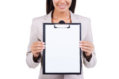 Copy space on her clipboard. Royalty Free Stock Photos