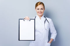 Copy space on her clipboard. Royalty Free Stock Image
