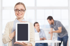 Copy space on her digital tablet. Royalty Free Stock Photos
