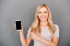 Copy space on her smart phone. Royalty Free Stock Photos