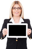 Copy space on her tablet. Royalty Free Stock Photo