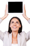 Copy space on her tablet. Stock Images