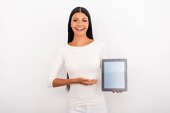 Copy space on her tablet. Royalty Free Stock Photography