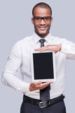 Copy space on his digital tablet. Stock Photos