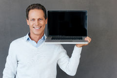 Copy space on his laptop. Royalty Free Stock Images