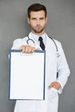 Copy space on his note pad. Royalty Free Stock Image