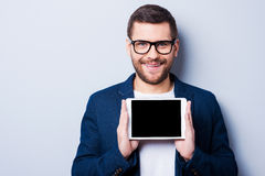 Copy space on his tablet. Royalty Free Stock Images