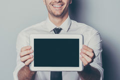 Copy space on his tablet. Royalty Free Stock Photo