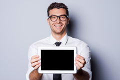 Copy space on his tablet. Royalty Free Stock Photos