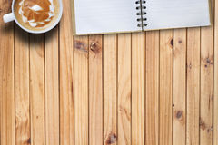 Copy space hot coffee and blank book on wooden table. top view b. Ackground. business on desk concept Stock Photos